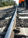 Figure 5: Witness marks at PoD (127.768 km) shown by line of stones on rail head. Source: ATSB