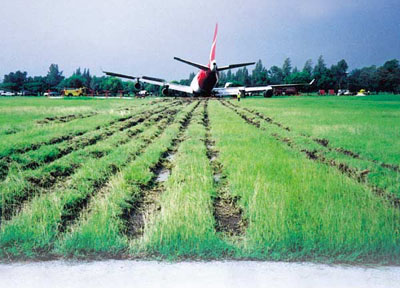 QF1 in field at end of runway