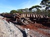 Derailed ore wagons and destroyed track infrastructure. Source: ATSB