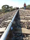 Witness marks at PoD (600.729 km) shown by line of stones on rail head. SOurce: ATSB