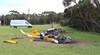 Figure 2: Helicopter wreckage with the broken tree branches in the background. Source: ATSB