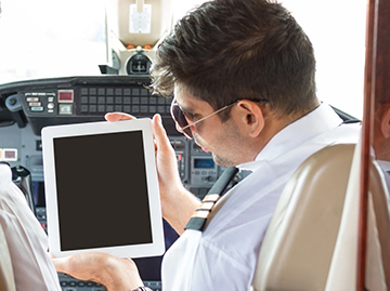 Generic tablet computer in aircraft cockpit - stock art photo