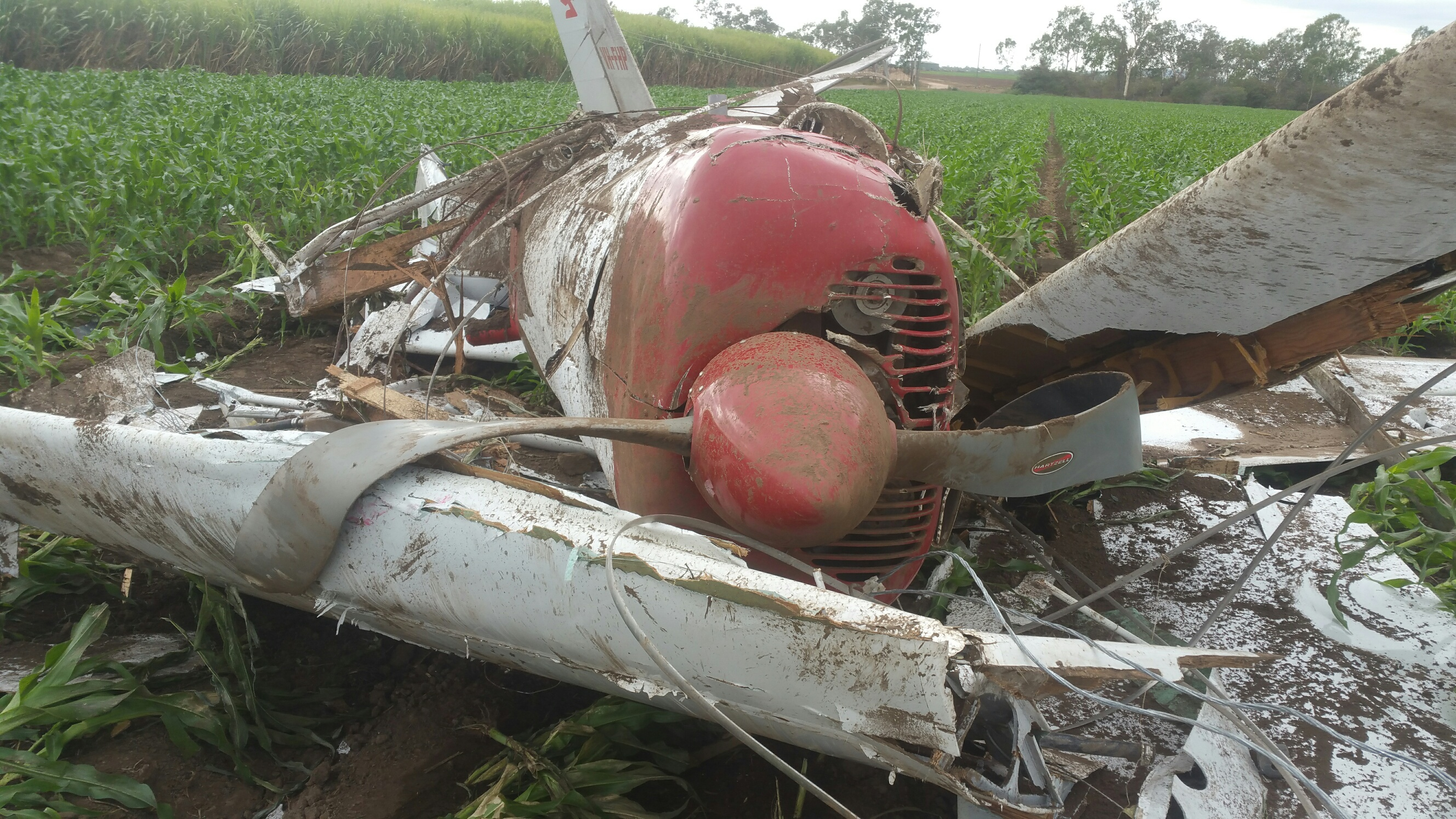 Figure 2: Photo of VH-FHP at the accident site showing damage to the aircraft and wires