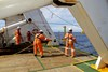 Personnel heave in the soft tow cable attached to the Dragon Prince deep tow fish during the recovery of the deep tow as Fugro Discovery completes the first stage of the search for the missing Malaysia Airlines flight MH370.Source: ATSB, photo by ABIS Chris Beerens, RAN.