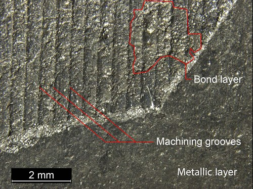 Close up of the metallic surface layer with key elements highlighted