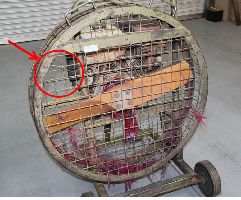 Figure 8: The cold-air inflation fan with remnants of the scarf (pre-existing minor cage damage highlighted)