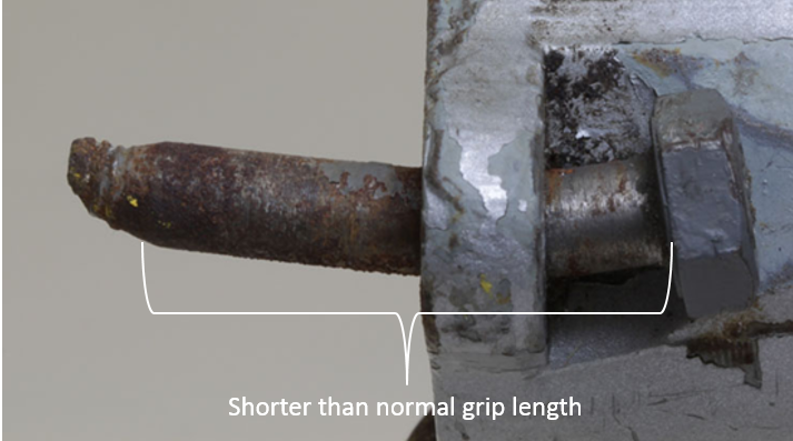 Figure 30: One of the non-standard upper attachment bolts fitted to VH-TSG showing the shorterthannormal grip length