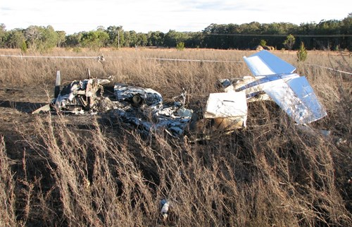 Figure 4: Aircraft wreckage showing the tail empennage inverted to the right and the propeller visible on the left (looking south-south-west)