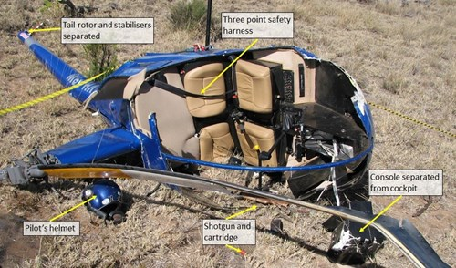 Figure 4: Helicopter wreckage, showing the ejected instrument console, damaged main rotor blade and destroyed canopy