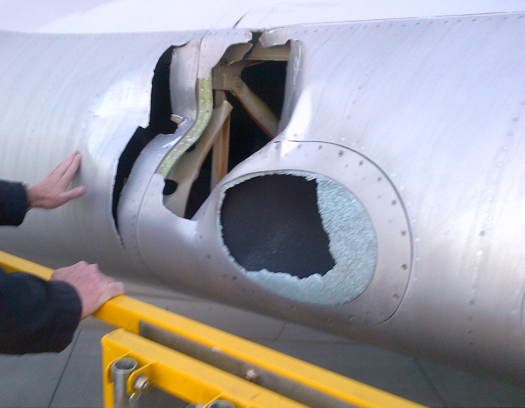 Figure 4: Close up of the damage to the left wing inboard leading edge and landing light cover