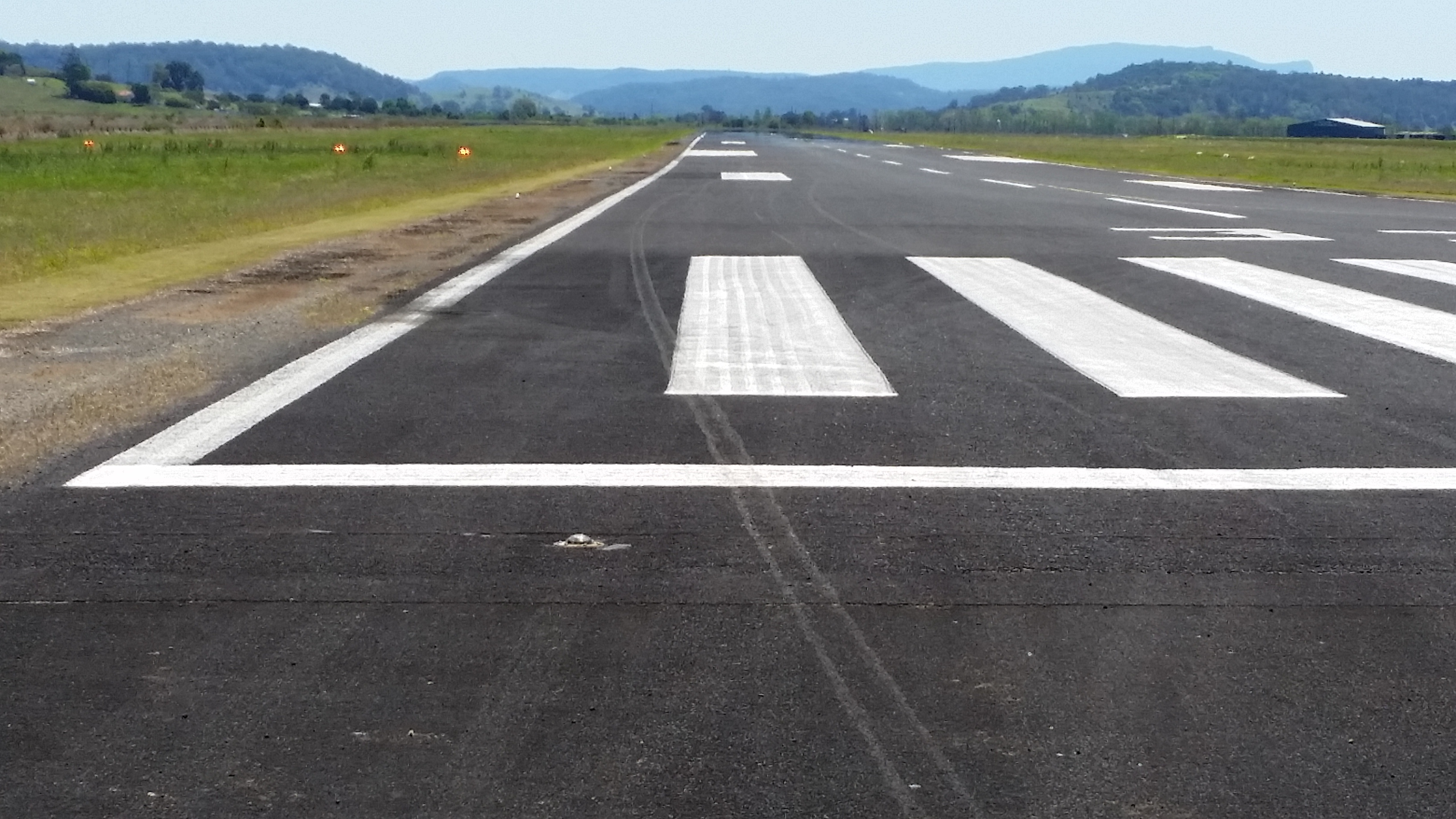 Figure 5: Southeast end of the runway showing right wheel contact marks on the runway and their position in relation to the runway centre line. Source: Aircraft owner