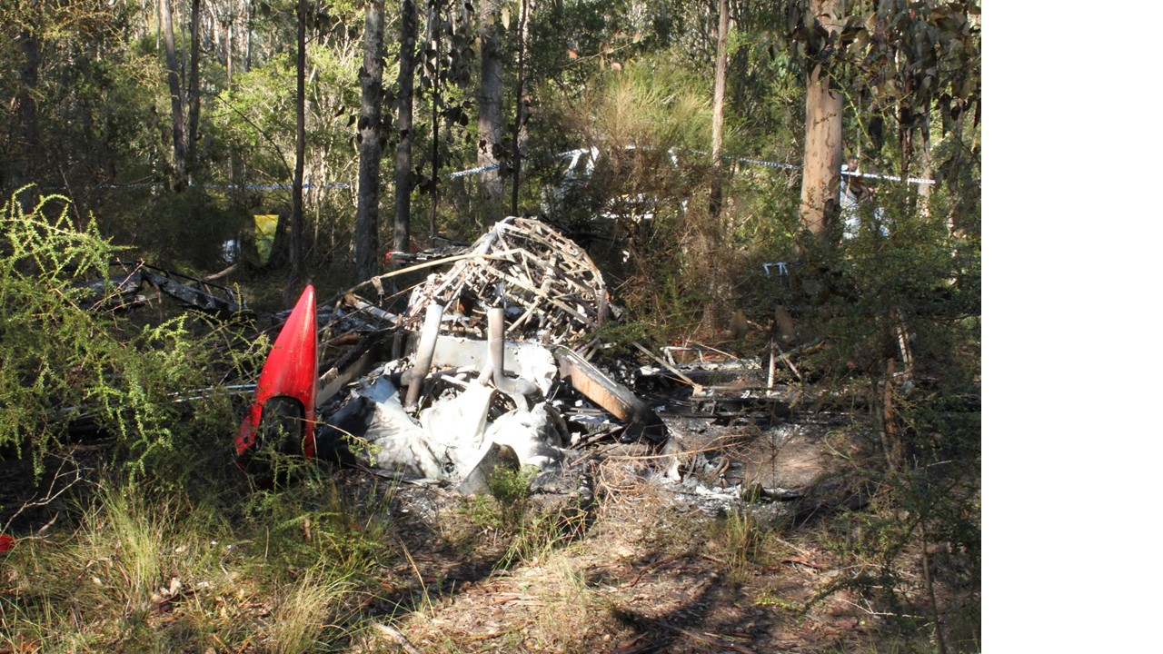 Figure 1: Accident site viewed from the front of the aircraft and showing the surrounding thick vegetation and minimal structural damage to the wings and airframe (consistent with the reported vertical descent)
