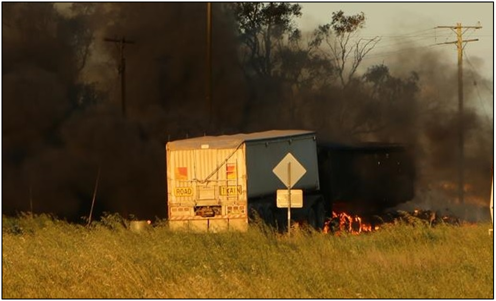 Figure 8: Post-collision fire, road-train truck (trailers) at Tullamore – Narromine Road railway crossing