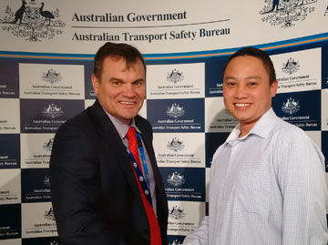 ATSB Chief Commissioner Greg Hood with Indonesian safety investigator Apib Prayogi at ATSB headquarters in Canberra