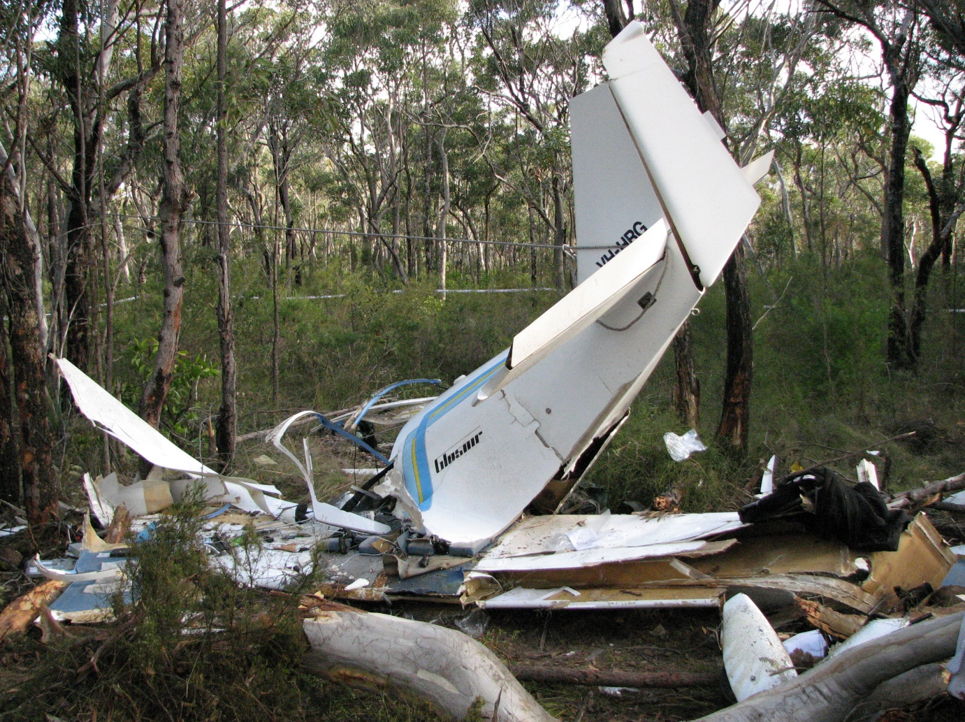 Figure 2: Aircraft wreckage. Note that the tail empennage is secured in an elevated position by being tied off to a nearby tree