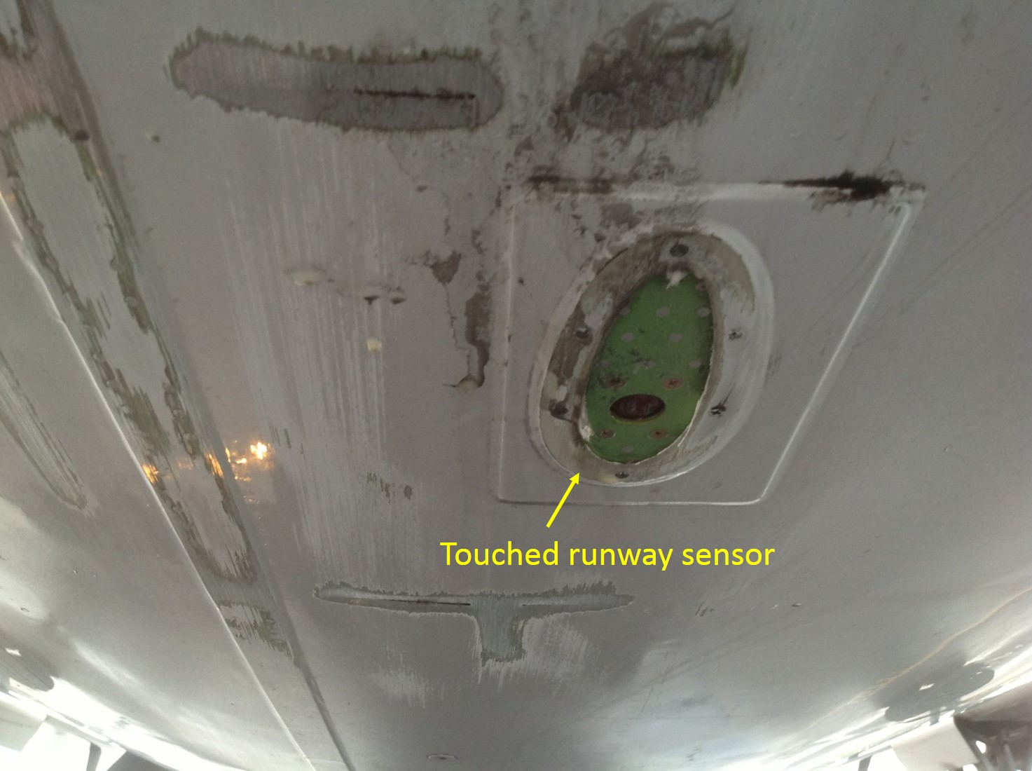 Figure 4: Damage to tail section of VH-QOS (looking aft)