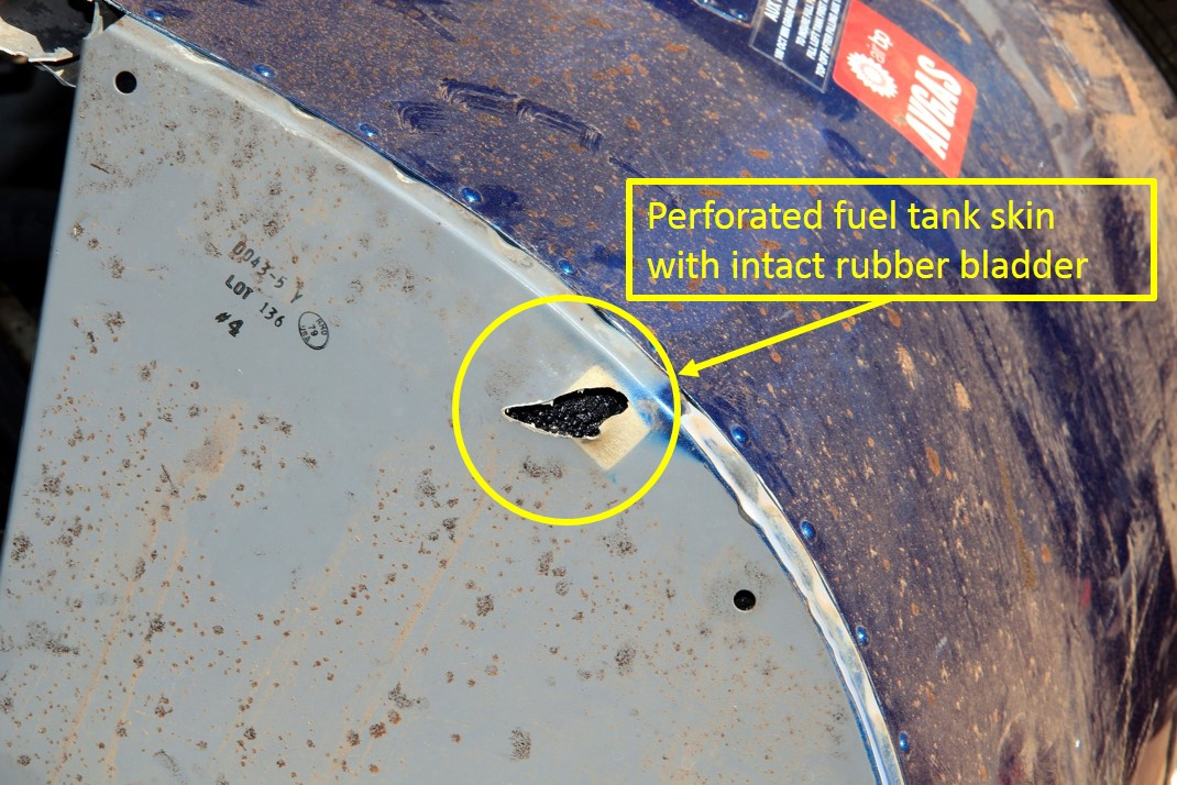 Figure 4: Perforated auxiliary fuel tank outer aluminium skin. Note the intact rubber bladder tank (circled in yellow)