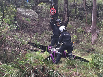 NSW Police at Bankstown and NSW Police Air Wing, recover the propeller assembly from bushland