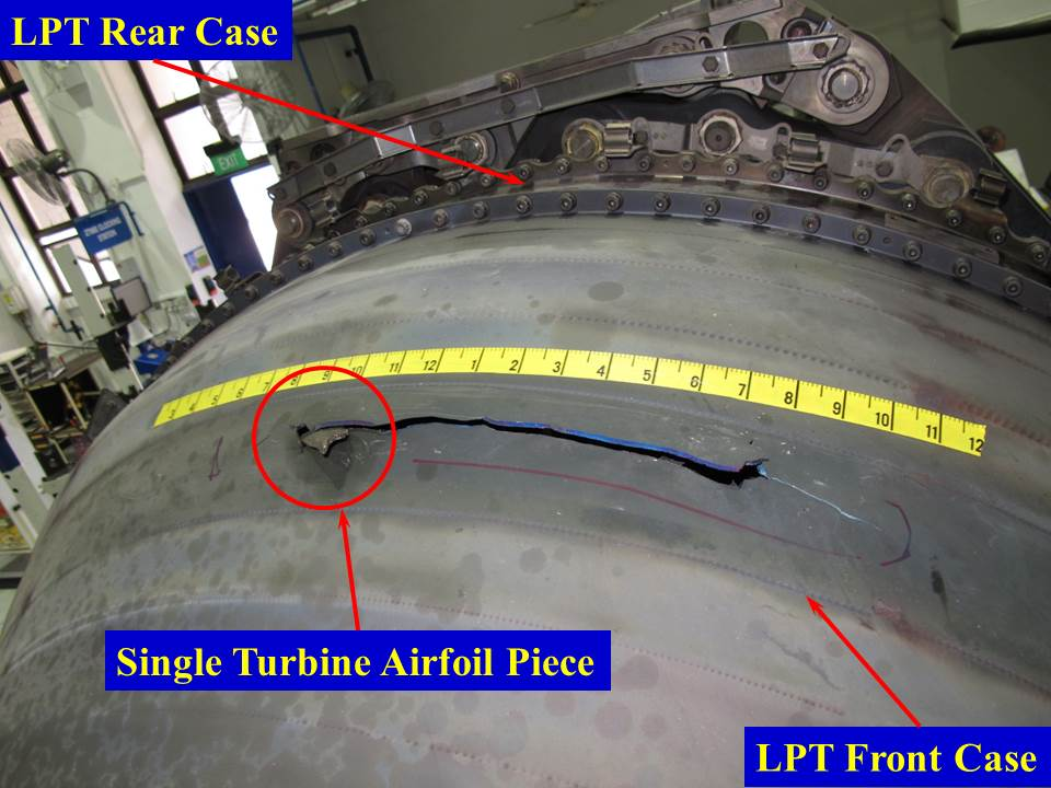 Figure 10: Low‑pressure turbine front case tear at the 11–12 o'clock position. Note that the scale is in inches and the view is looking aft