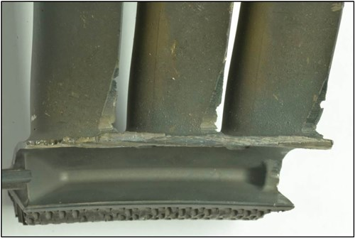 Figure 12: Stage four low pressure turbine vane cluster showing clashing damage to the inside diameter of the shroud and aerofoils