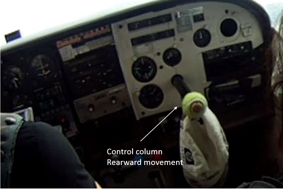 Figure 9: VH-FRT in flight on 8 February 2014 with the copilot's control column protruding out of the control panel