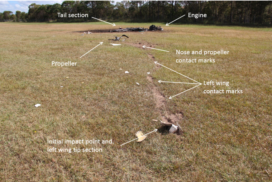 Figure 14: Main wreckage and accident site looking north-north-west, showing the left wing point of impact in the foreground and the fuselage and engine in the background