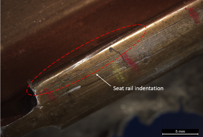 Figure 22: Rear of outboard seat rail showing indentation damage