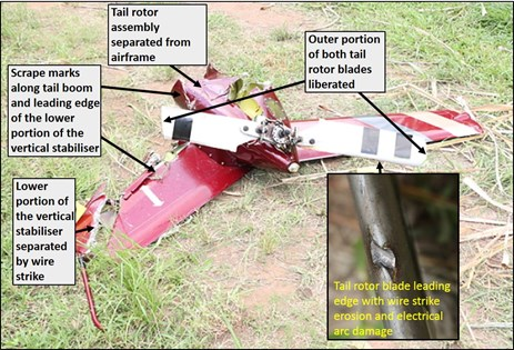 Figure 4: Separated tail rotor assembly, showing the liberation of the outer portion of both tail rotor blades, electrical arcing to the leading edge of one tail rotor blade (at inset) and the separated lower portion of the vertical stabilizer