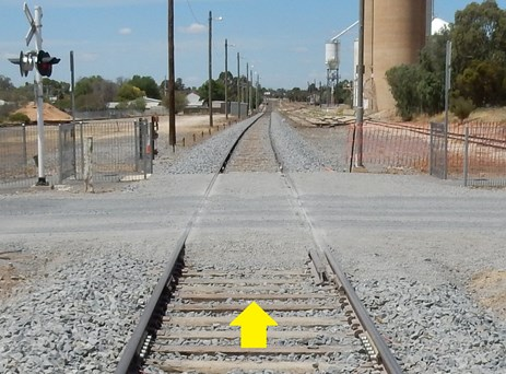 Figure 7: The William Street level crossing after reinstatement, similar in construction to the pre-derailment installation except timber sleepers used instead of concrete.