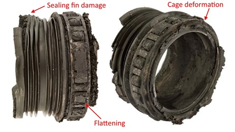 Figure 7: The seized front bearing and labyrinth seal, showing blackening from severe heat distress, flattening of the rollers, deformation of the cage and sealing fins