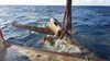 Tail section of aircraft wreckage being recovered by Pacific Marine Group for ATSB