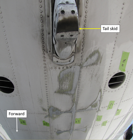 Figure 1: Damage to the tail skid an underside of the rear fuselage
