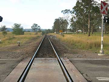 Near hit with detrained passengers on track, Kilbride, NSW, on 22 May 2014