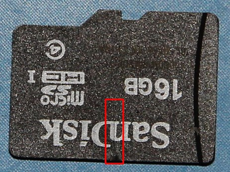Figure 1: Micro-SD card recovered from the avionics unit with the crack highlighted inside the red box