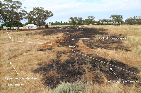 Figure 3: Accident site, showing ground impact marks and the main wreckage in the background