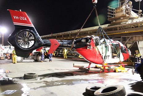 Figure 6: Helicopter wreckage being lifted onto the dock. Source: ATSB.