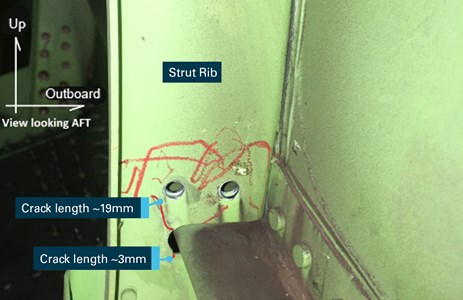 Figure 3: A strut rib in-situ within the No. 2 pylon with two cracks identified. Source: Boeing, annotated by the ATSB