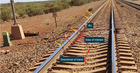 Figure 8: West track, location of repairs to rail sections near the 67 km mark. Video image capture of the west track showing the east and west rail near the insulated rail joints at the 67 km mark. There were a number of welds in close proximity (orange arrows). Source: Rail Technology International, annotated by ATSB