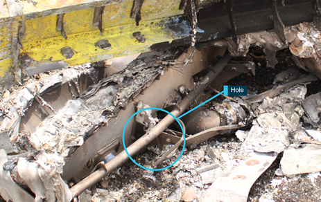 Figure 10: Gate box wreckage showing hole in gate box torque tube where bolt was missing. Source: ATSB