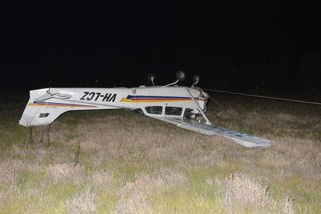 Figure 1: Aircraft wreckage (note power line fouling the nose wheel). Source: South Australia Police