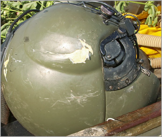 Figure 3: Damage to the left side of the pilot's flight helmet. Source: Police