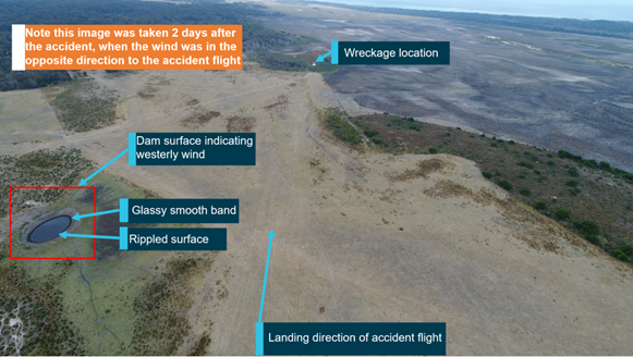 Figure 3: Airfield looking in the landing direction (west) from runway threshold, showing dam surface. Note: image was taken 2 days after the accident, in a westerly wind. Source: ATSB