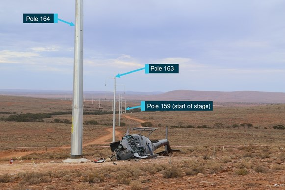 Figure 1: The accident site near pole 164 on Pernatty Station. Also visible are the                    previously strung poles. The direction of travel of the helicopter was from pole                  163 to pole 164. Source: ATSB