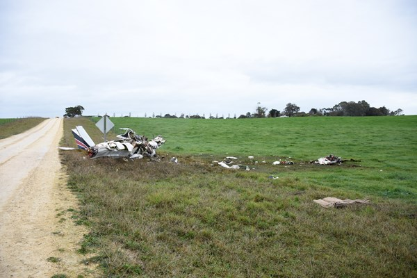 Accident site, showing the engine and propeller location, the left and right wing impact marks and the main wreckage