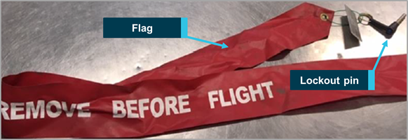 Figure 1: Thrust reverser lockout pin and warning flag (non-reflective)
