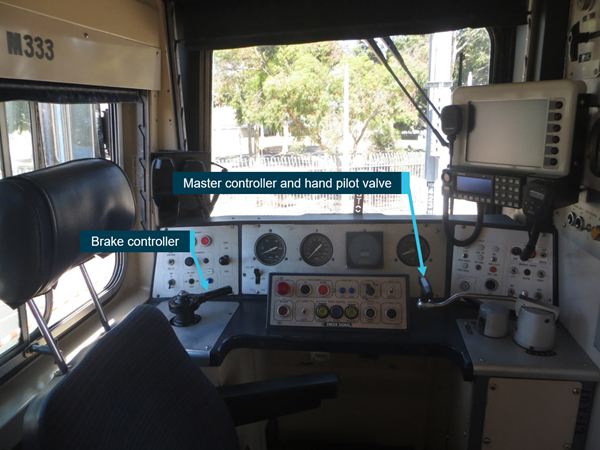 Figure 2: Comeng driver's cab of 333M, showing location of the brake controller, and combined master controller with hand pilot valve.