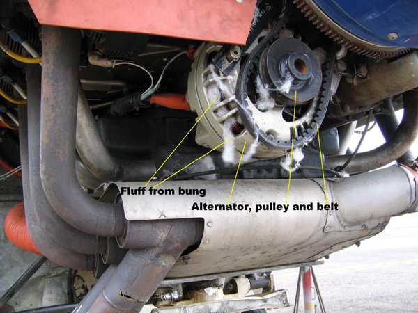 Figure 1: The dislodged alternator belt and fluff from the bungs