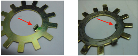 Figure 2: New tang washer with an undamaged locking tab and the subject tang washer with broken locking tab