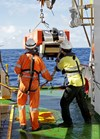 Fugro Discovery crew members deploy 'Dragon Prince', the EdgeTech DT-1 towfish that is being used to search the seafloor for MH370. Source: ATSB, photo by ABIS Chris Beerens, RAN.