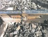 Figure 11: Photograph from the 11 September 2013 derailment, showing marks on the rail gauge face consistent with a left hand wheel dropping inside the common rail. Source: Pacific National.